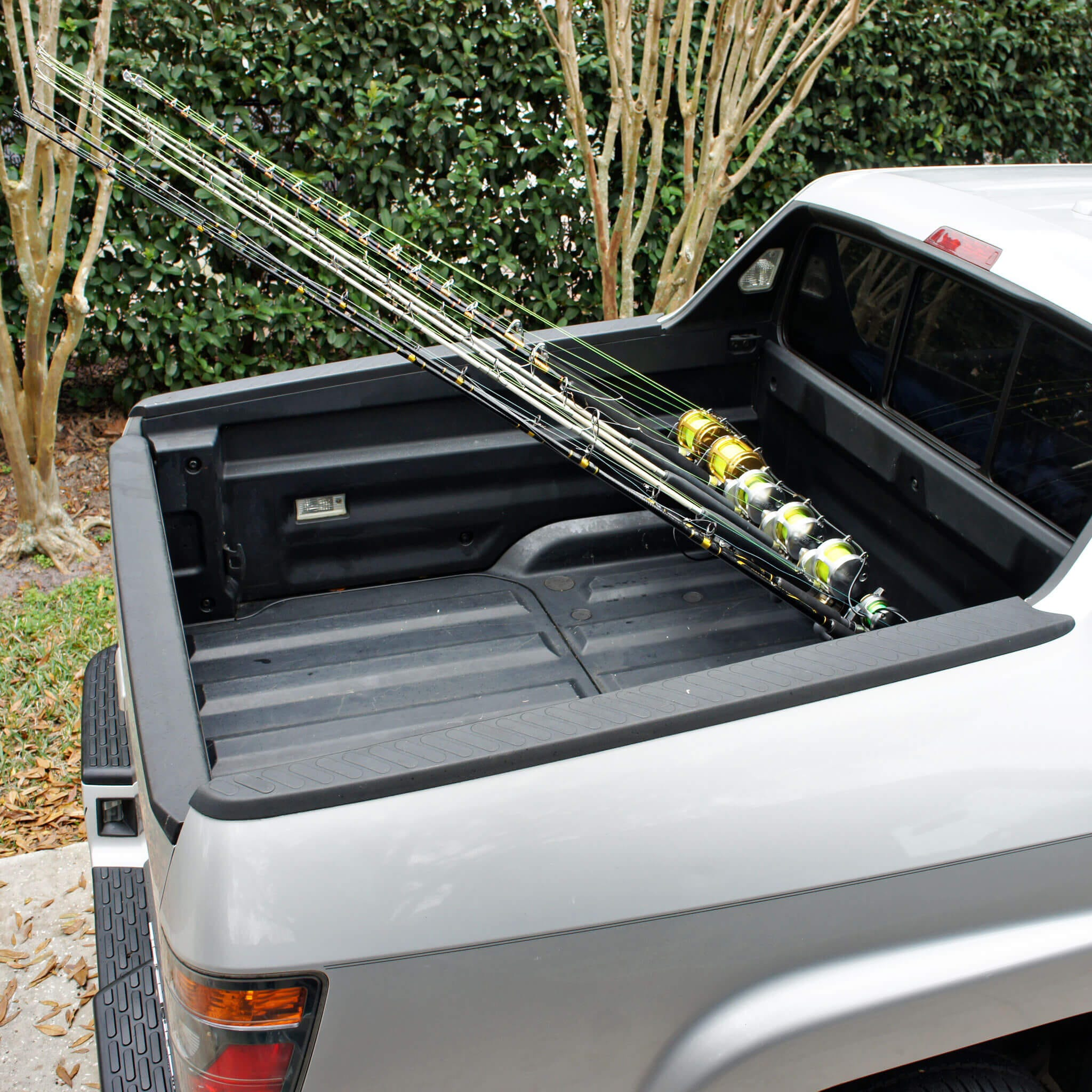 Vehicle fishing rod holder vehicle ideas for Truck bed fishing rod holder